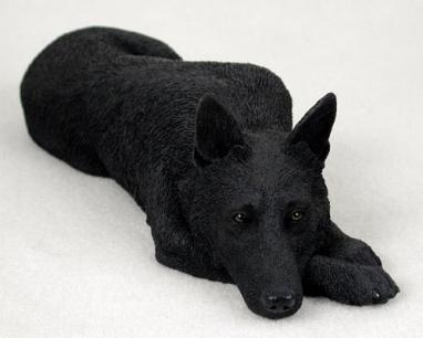 Balck GSD Statue Laying Down